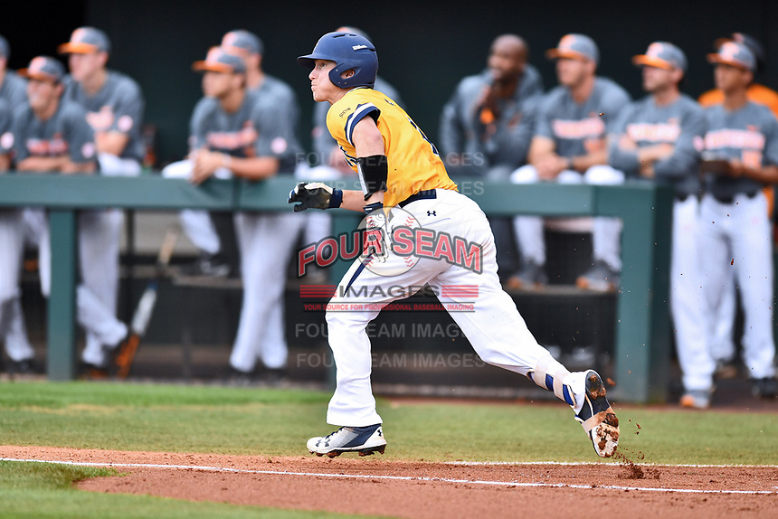 University of North Carolina Greensboro (UNCG) Spartans center fielder Andrew Moritz (4) runs to first base during a game against the Tennessee Volunteers at Lindsey Nelson Stadium on February 24, 2018 in Knoxville, Tennessee. The Volunteers defeated Spartans 11-4. (Tony Farlow/Four Seam Images)