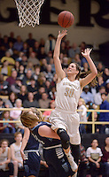 NWA Democrat-Gazette/BEN GOFF @NWABENGOFF<br /> Madison Brittain of Bentonville makes a shot over Maei Mains of Springdale Har-Ber on Friday Jan. 15, 2016 during the game in Bentonville's Tiger Arena.