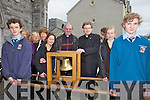 RINGING OUT: Students and locals greeting the Eucharistic Congress Bell at Listowel Church on Friday, pictured here with Canon Declan O'Connor PP and Fr Bernard Healy (Dingle).