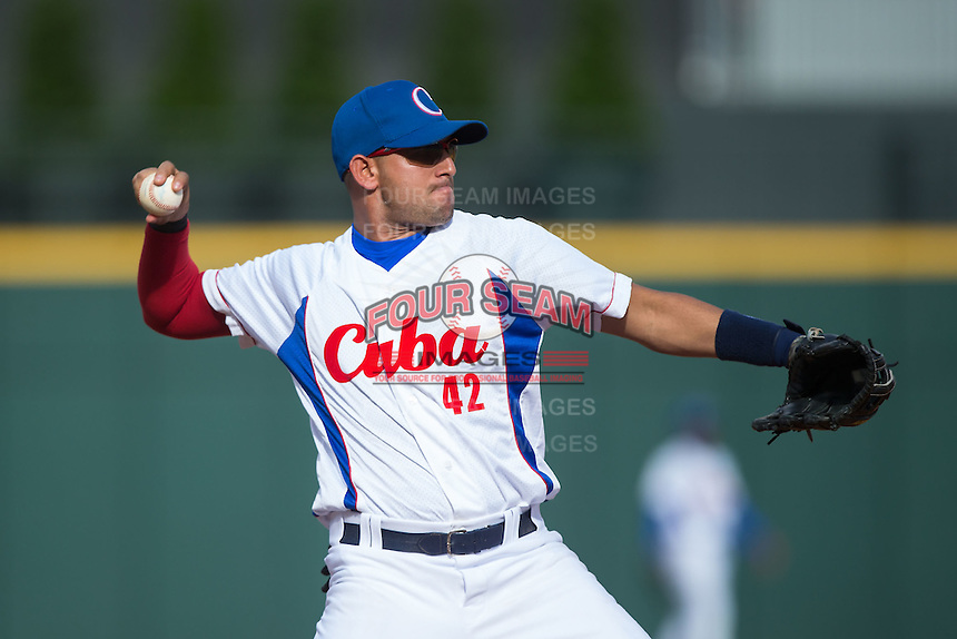 Yordan Manduley Escalona (42) of the Cuban National Team on defense against the US Collegiate National Team at BB&T BallPark on July 4, 2015 in Charlotte, North Carolina.  The United State Collegiate National Team defeated the Cuban National Team 11-1.  (Brian Westerholt/Four Seam Images)