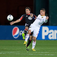 John Thorrington (8) of D.C. United fights for the ball with Luis Gil (21) of Real Salt Lake during the game at RFK Stadium in Washington, DC.  D.C. United defeated Real Salt Lake, 1-0.