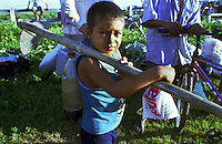"A young boy member of Brazil's Landless Rural Workers' Movement (MST) occupy  ranch at Belém-Brasilia Highway in Pará state of Brazil, on April 2002. The invasion is part of a celebration called ""Red April"" reminding the massacre in which 19 MST members were killed by the police in Eldorado dos Carajas."