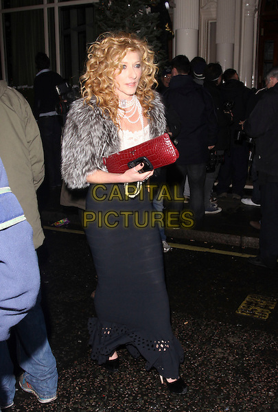 KELLY HOPPEN .Leaving a party at The Connaught Hotel, London, England, UK, .December 8th 2009..full length grey gray fur coat jacket red clutch bag black long maxi cut out skirt shoes pearl necklace white top dress .CAP/AH.© Adam Houghton/Capital Pictures.