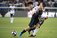 SAN JOSE, CA - AUGUST 25: Magnus Eriksson #7 of the San Jose Earthquakes  and Inbeom Hwang #4 of the Vancouver Whitecaps during a game between Vancouver Whitecaps FC and San Jose Earthquakes at Avaya Stadium on August 24, 2019 in San Jose, California.