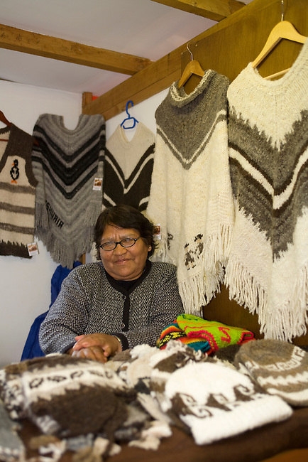 Woman selling knitwear made from wool or Alpaca in a craft market close to the harbour. Ushuaia. Antarctica