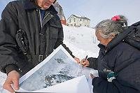 Annie Kirk from the native village of Buckland, signs a poster in the ghost town of Candle, Alaska, the half way point of the 2008 All Alaska Sweepstakes sled dog race.