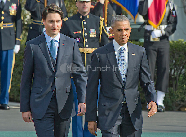 United States President Barack Obama, right and Prime Minister Justin Trudeau of Canada, left, review the troops during an Arrival Ceremony on the South Lawn of the White House in Washington, DC on Thursday, March 10, 2016. <br /> Credit: Ron Sachs / CNP/MediaPunch