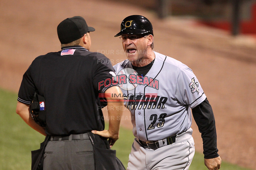 Omaha Storm Chasers manager Mike Jirschele #23 argues a call with home plate umpire Tripp Gibson during a game against the Nashville Sounds at Greer Stadium on April 25, 2011 in Nashville, Tennessee.  Omaha defeated Nashville 2-1.  Photo By Mike Janes/Four Seam Images