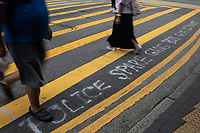 "Graffiti is sprayed on the streets in Central, Hong Kong by protestors. The graffiti reads ""Hong Kong police protect gangs (triads) but not the public"".  Hong Kong has undergone 9 weeks of protests that began with the introduction of an extradition bill allowing criminals to be deported to the legal system in Mainland China but has grown wider into a pro-democracy movement."