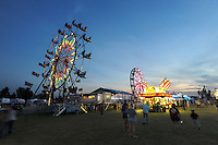 NWA Democrat-Gazette/ANDY SHUPE<br /> Fairgoers walk through the midway Thursday, Sept. 3, 2015, during the Washington County Fair at the county fairgrounds in Fayetteville.
