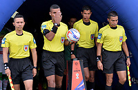 IBAGUÉ - COLOMBIA, 03-03-2018: Leonard Mosquera, arbitro principal, y jueces auxiliares ingresan al campo de juego previo al encuentro con La Equidad por la fecha 6 de la Liga Águila I 2018 jugado en el estadio Manuel Murillo Toro de la ciudad de Ibagué. / Leonard Mosquera, main referee, and assitant referees go inside the field prior the first leg match against La Equidad for date 6 of the Aguila League I 2018 played at Manuel Murillo Toro stadium in Ibague city. Photo: VizzorImage / Juan Carlos Escobar / Cont