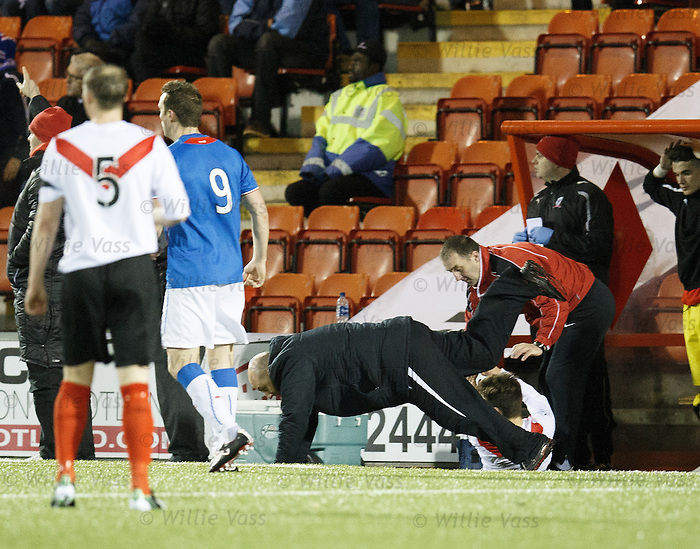 Airdrie manager Gary Bollan slide tackled by one of his own players