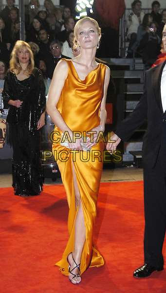 JOELY RICHARDSON.Bafta Awards - British Academy Awards at Odeon Leicester Square.15 February 2004.full length, full-length, orange wrap dress, brooch, black strappy sandals, silver clutch purse.www.capitalpictures.com.sales@capitalpictures.com.©Capital Pictures