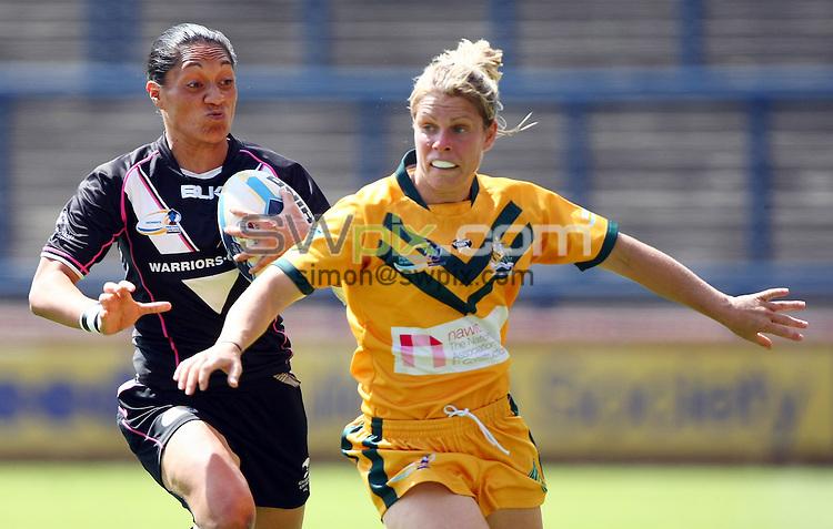 PICTURE BY VAUGHN RIDLEY/SWPIX.COM - Rugby League - Festival of World Cups, Women's Final - Australia Women v New Zealand Women - Headingley, Leeds, England - 14/07/13 - New Zealand's Sarina Fiso and Australia's Jessica Palmer.