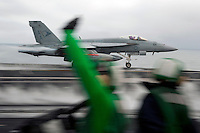 101217-N-7981E-074 PACIFIC OCEAN (Dec. 17, 2010)- An F/A-18E Super Hornet assigned to Strike Fighter Squadron 81 rushes past Air Department Sailors as it launches from the flight deck of USS Carl Vinson (CVN 70). Carl Vinson and Carrier Air Wing (CVW) 17 are currently on a three-week composite training unit exercise (COMPTUEX) followed by a western Pacific deployment. (U.S. Navy photo by Mass Communication Specialist 2nd Class James R. Evans / RELEASED)
