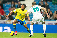 Real Madrid's Marcos Llorente (r) and UD Las Palmas' Loic Remy during La Liga match. November 5,2017. (ALTERPHOTOS/Acero)