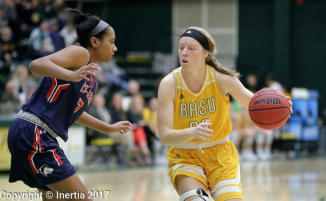 SPEARFISH, SD: DECEMBER 30:  Hannah Cass #30 of Black Hills State drives toward Khiya Adams #13 of CSU Pueblo during their game Saturday evening at the Donald E. Young Center in Spearfish, S.D.   (Photo by Dick Carlson/Inertia
