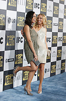 US actress Rosario Dawson and Maria Bello arrive at the 25th Independent Spirit Awards held at the Nokia Theater in Los Angeles on March 5, 2010. The Independent Spirit Awards is a celebration honoring films made by filmmakers who embody independence and originality..Photo by Nina Prommer/Milestone Photo
