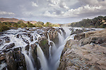 The falls are formed by the Kunene River which divides Angola on the north (left) and Namibia on the south (right).
