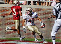 TALLAHASSEE, FLA. 4/16/11-FSUG&G041611 CH-Garnet's Justin Bright can't stop Gold's James Dolan from scoring during first half action in the Florida State University Garnet and Gold game Saturday in Tallahassee..COLIN HACKLEY PHOTO