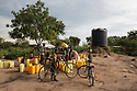 Uganda - Palorinya Refugee Camp - South Sudanese children collect water from a water distribution point located inside the refugee camp.