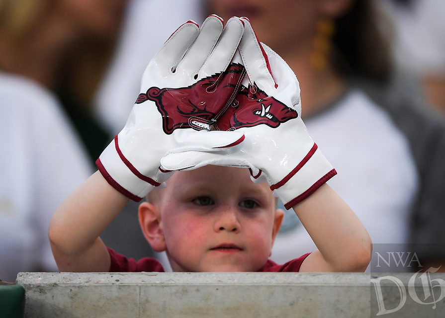 NWA Democrat-Gazette/CHARLIE KAIJO A young Arkansas Razorbacks fan holds his hands out during the second quarter of a football game, Saturday, September 8, 2018 at Colorado State University in Fort Collins, Colo.