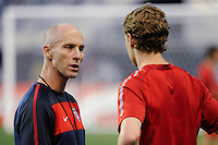 United States (USA) head coach Bob Bradley of the United States (USA) talks with Jonathan Spector during a practice session at PPL Park in Chester, PA, on October 11, 2010.