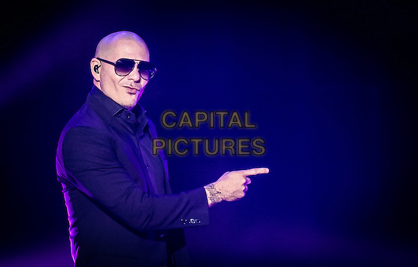 LAS VEGAS, NV - September 23: ***HOUSE COVERAGE*** Pitbull premieres his residency show at The Axis Theater at Planet Hollywood Resort in Las Vegas, NV on September 23, 2015. <br /> CAP/MPI/EKP<br /> &copy;EKP/MPI/Capital Pictures