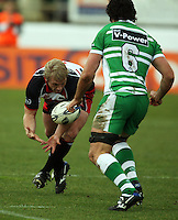 Counties hooker Matt Holloway picks up the ball under pressure from Nick Crosswell during the Air NZ Cup rugby match between Manawatu Turbos and Counties-Manukau Steelers at FMG Stadium, Palmerston North, New Zealand on Sunday, 2 August 2009. Photo: Dave Lintott / lintottphoto.co.nz