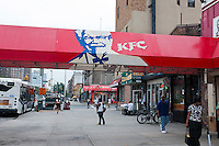 A Kentucky Fried Chicken franchise restaurant is seen on Lenox Avenue in Harlem in New York on Saturday, July 28, 2012.  (© Richard B. Levine)