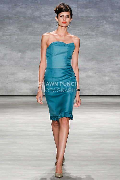Model walks runway in an outfit from the b michael AMERICA Couture Spring 2015 collection, during Mercedes-Benz Fashion Week Spring 2015 in New York City.