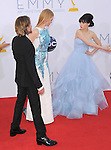 Zooey Deschanel tells Nicole Kidman Urban and Keith Urban to pass by at The 64th Anual Primetime Emmy Awards held at Nokia Theatre L.A. Live in Los Angeles, California on September  23,2012                                                                   Copyright 2012 Hollywood Press Agency