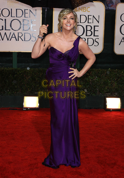 JANE KRAKOWSKI.67th Golden Globe Awards held Beverly Hilton, Beverly Hills, California, USA..January 17th, 2010.globes full length purple silk satin one shoulder maxi dress clutch bag hand on hip umbrella  .CAP/ADM/KB.©Kevan Brooks/Admedia/Capital Pictures
