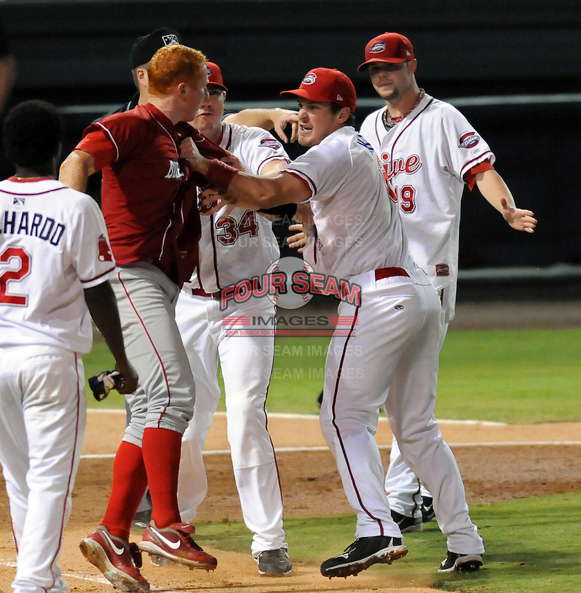 The benches clear in a brawl after a close play at the plate at the end of the fifth inning in Game 2 of the South Atlantic League Championship Series between the Greenville Drive and Lakewood BlueClaws on Sept. 14, 2010, at Fluor Field at the West End in Greenville, S.C. Leandro Castro and Julio Rodriguez of Lakewood and Michael Almanzar and Derrik Gibson were ejected by HP umpire Derek Mollica. Photo by: Tom Priddy/Four Seam Images