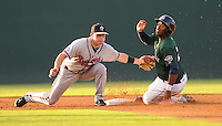Infielder Matt Lipka (5) of the Rome Braves applies the tag too take to prevent Brandon Jacobs (24) of the Greenville Drive from stealing in a game on July 17, 2011, at Fluor Field at the West End in Greenville, South Carolina. Lipka was Atlanta's first-round pick in the 2010 First-Year Player Draft. (Tom Priddy/Four Seam Images)