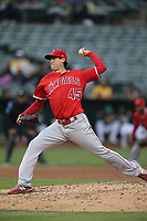 OAKLAND, CA - JUNE 15:  Tyler Skaggs #45 of the Los Angeles Angels of Anaheim pitches against the Oakland Athletics during the game at the Oakland Coliseum on Friday, June 15, 2018 in Oakland, California. (Photo by Brad Mangin)