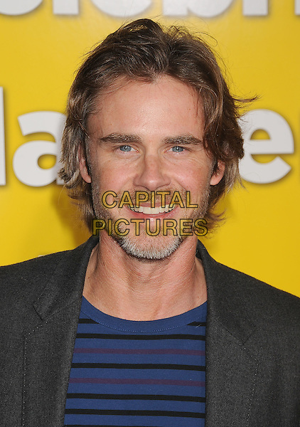 """SAM TRAMMELL .arriving at the Los Angeles premiere of """"Paul"""" at Grauman's Chinese Theatre in Hollywood, California, USA, .March 14th, 2011. .portrait headshot blue striped beard facial hair smiling .CAP/ROT/TM.©TM/Roth/Capital Pictures"""