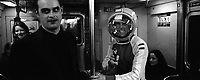 A man dressed as a spaceman on halloween in the subway. Subway series shot in New York between the years 1998 and 2001