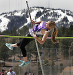 "LEAD, S.D. -- MAY 4, 2013 -- Stephanie Johnson of Belle Fourche makes one last attempt at the pole vault with a snow-capped Terry Peak as a backdrop at the 2013 Mountain West Invitational T&F Meet Saturday at Mountain Top in Lead, S.D. Johnson won the event with a height of 8' 3"". (Photo by Richard Carlson/dakotapress.org"