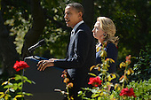 United States President Barack Obama (L) delivers remarks beside US Secretary of State Hillary Clinton (R) on the killing of US ambassador to Libya, Christopher Stevens, and three embassy staff, in the Rose Garden of the White House in Washington DC, USA, 12 September 2012. Gunmen attacked the US consulate in Benghazi, killing Stevens and three others, late 11 September 2012, while another assault took place on the US embassy in Cairo..Credit: Michael Reynolds / Pool via CNP