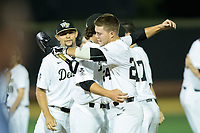 Gavin Sheets (24) of the Wake Forest Demon Deacons gets a hug from teammate Griffin Roberts (43) after his game winning hit in the bottom of the 9th inning against the West Virginia Mountaineers in Game Four of the Winston-Salem Regional in the 2017 College World Series at David F. Couch Ballpark on June 3, 2017 in Winston-Salem, North Carolina.  The Demon Deacons walked-off the Mountaineers 4-3.  (Brian Westerholt/Four Seam Images)