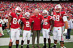 Wisconsin Badgers captains (from left to right) Lance Kendricks (84), Jay Valai (2), Culmer St.Jean (15) and Gabe Carimi (68) pose with honorary captain Pat Richter prior to an NCAA college football game against the San Jose State Spartans on September 11, 2010 at Camp Randall Stadium in Madison, Wisconsin. The Badgers beat San Jose State 27-14. (Photo by David Stluka)