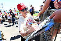 "NWA Democrat-Gazette/J.T. WAMPLER Lori Petty signs autographs Sunday May 7, 2017 during the ""A League of Their Own"" reunion softball game at Arvest Ballpark in Springdale. Petty played Kit Keller in the 1992 movie. The event concluded the Bentonville Film Festival."