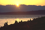 Seattle, Puget Sound, Beach Scene, Sunset over Olympics, from Lincoln Park, West Seattle, Seattle, Washington State, Pacific Northwest, North America..