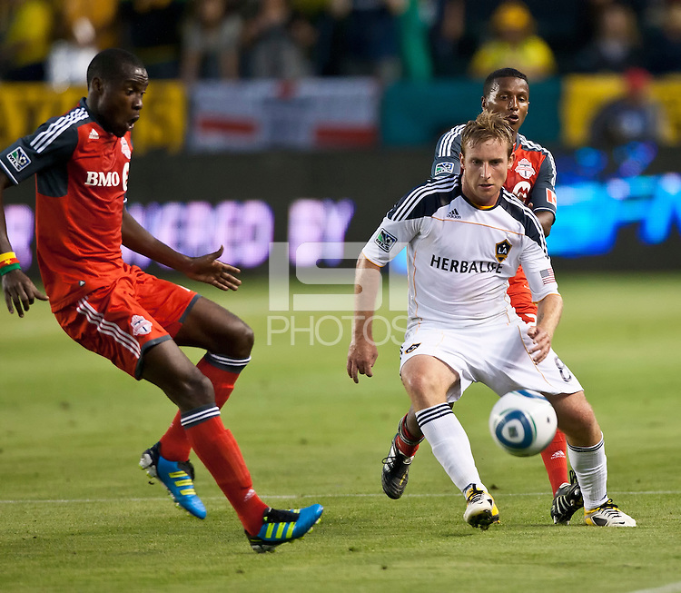 CARSON, CA – June 11, 2011: Toronto FC midfielder Tony Tchani (22) and LA Galaxy midfielder Chris Birchall (8) during the match between LA Galaxy and Toronto FC at the Home Depot Center in Carson, California. Final score LA Galaxy 2, Toronto FC 2.