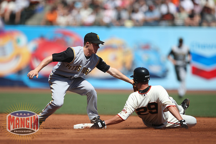 SAN FRANCISCO - SEPTEMBER 7:  Scott McClain of the San Francisco Giants, right, is out trying to steal second base as Pittsburgh Pirates shortstop Brian Bixler applies the tag during the game at AT&T Park in San Francisco, California on September 7, 2008.  The Giants defeated the Pirates 11-6.  Photo by Brad Mangin