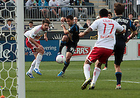 CHESTER, PA - OCTOBER 27, 2012:  Danny Cruz (44) of the Philadelphia Union  gets the ball past  Heath Pearce (3) of the New York Red Bulls during an MLS match at PPL Park in Chester, PA. on October 27. Red Bulls won 3-0.