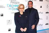 French-Greek TV host Nikos Aliagas (R) and French singer Sylvie Vartan pose during a photo call for the opening of Aliagas' photography exhibition, on January 16, 2017, in Paris.