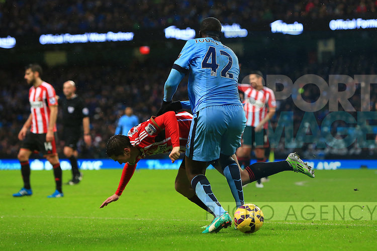 Yaya Toure of Manchester City bundles over Adam Johnson of Sunderland - Manchester City vs. Sunderland - Barclay's Premier League - Etihad Stadium - Manchester - 28/12/2014 Pic Philip Oldham/Sportimage