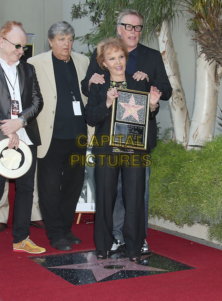 "Peter Asher, Phil Everly and Gary Busey and Maria Elena Holly.Buddy Holly posthumous STAR Induction into ""The Hollywood Walk of Fame"" on his 75th Birthday held in front of the Capital Records Building on Vine Street, Hollywood, California, USA..September 7th, 2011.full length grey gray blue black white beige suit hands on shoulders plaque  .CAP/ADM/RE.©Russ Elliot/AdMedia/Capital Pictures."